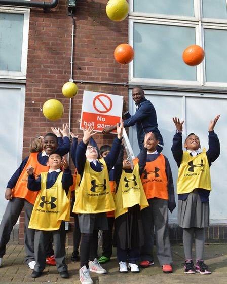 Children from Brook House Primary School celebrate with footballer Ledley King. Photo: Polly Hancoc