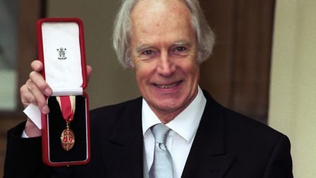 Sir George Martin with his Knighthood at Buckingham Palace in 1996. Picture: Neil Munns/PA