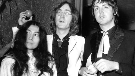 Beatle John Lennon and girlfriend Yoko Ono with Beatle Paul McCartney at the premiere of the new Bea