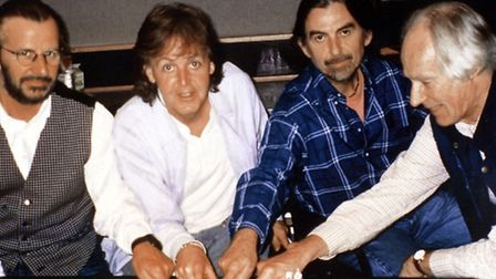 Ringo Starr, Paul McCartney, George Harrison with producer George Martin during recording of a new B
