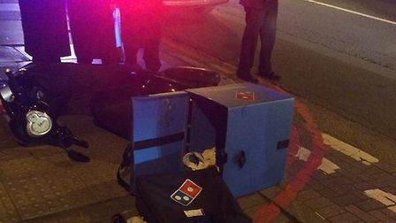 The crash involved a pizza delivery moped and a car. Picture: @999London