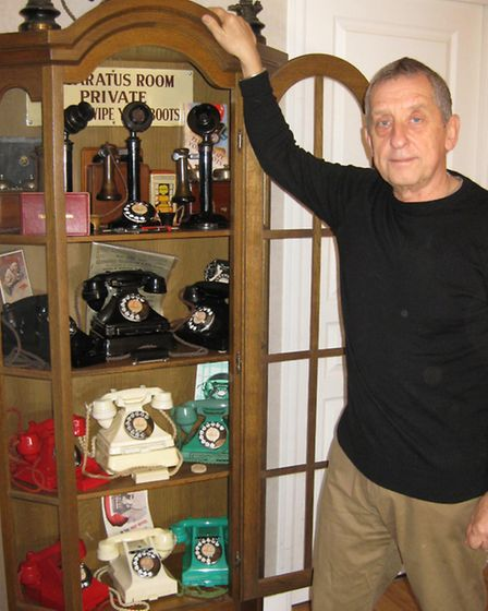 Stanley with his collection of antique phones