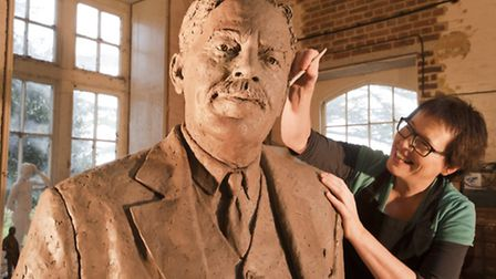 Sculptor Hazel Reeves works on the statue of Sir Nigel Gresley. Picture by Roger Bamber.
