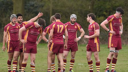 The Hampstead squad reflect on their late defeat to Tabard after the final whistle. Pic: Paolo Minol
