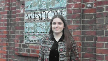Beth Foster-Ogg outisde her old school, Clapton Girls Academy