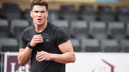 Anthony Ogogo says he was the victim of racial abuse from a fellow Norwich City fan after the Canari