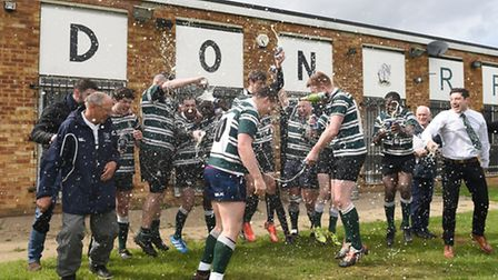 Hendon's players pop open the champagne outside their clubhouse. Pic: Paolo Minoli