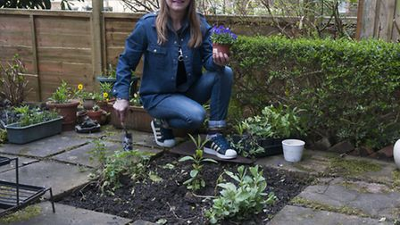 Project Dirt - Lift one paving stone campaign . Annie Cartwright pictured working in her garden in S