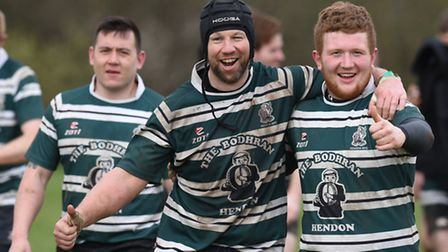 Hendon's Donal O'Sullivan (centre) and Lawrence Moore celebrate Saturday's victory over Haringey Rhi