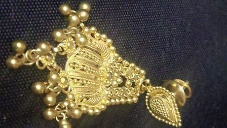 Gold earrings which were allegedly stolen