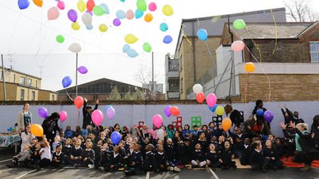 Whitmore primary school pupils launch balloons in the playground