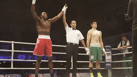 Lawrence Okolie (left) celebrates a win for GB Lionhearts