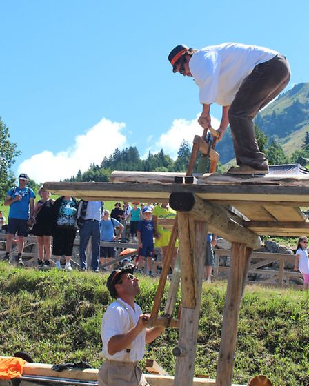 Demonstration on buildling a house at the Fete de l'Alpage in Le Chinaillon, photo Emma Bartholomew