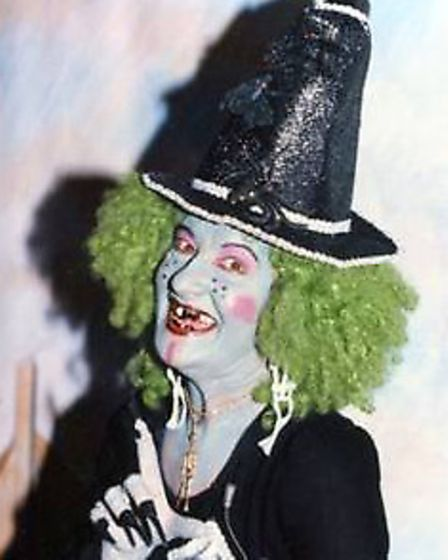Avril Randall as Evil Edna - green hair, bluish skin, spots, warts, talons and all - in Jack and the