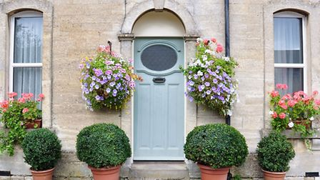 Hanging baskets on the exterior of a Victorian cottage. PA Photo/thinkstockphotos