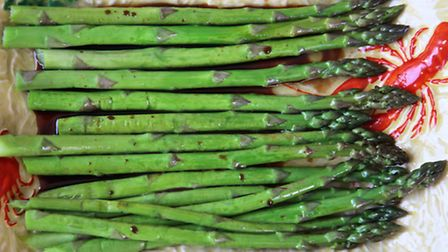 Combine asparagus with maple syrup and balsamic vinegar. Picture: Kerstin Rodgers