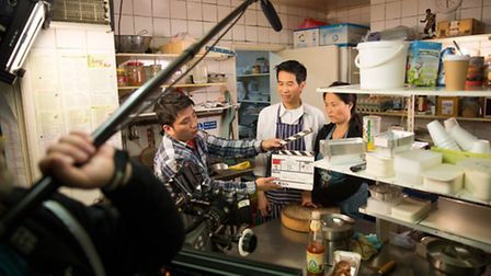 A scene in action on the set of Wok