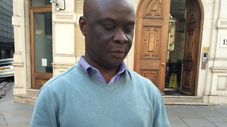 Marcel Addai's grandfather Matthew reads a statement from the family outside the Old Bailey