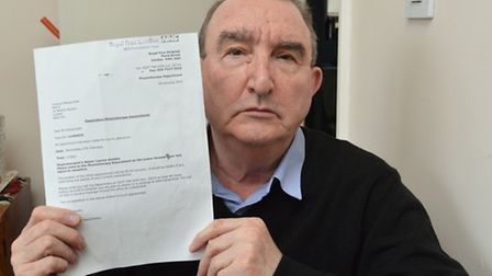 Terrence Pellegrinetti with his letter from the Royal Free Hospital offering him an appointment on a