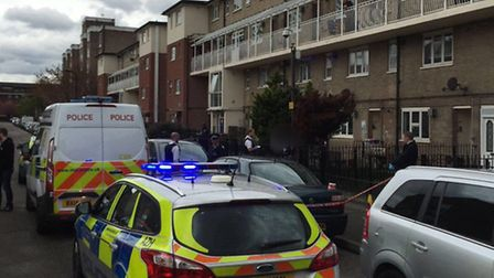 Police at the scene of the stabbing. Picture: @MPSHackney