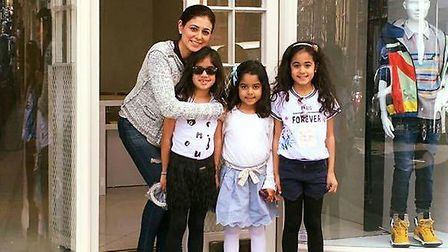 Saby Thukral was struggling to shop locally for her three daughters, pictured outside the shop in He