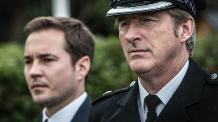 Detective Sergeant Steve Arnott played by Martin Compston and Superintendent Ted Hastings played by