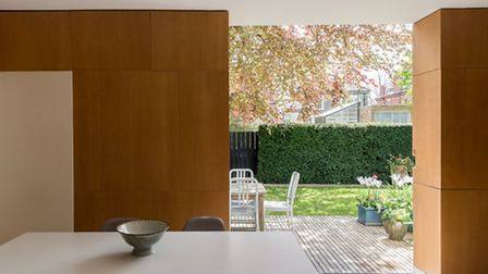 The 2002 kitchen extention brings the outdoors indoors with plenty of room for informal dining