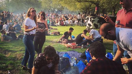 People were enjoying the hottest day of the year in the park. There is no suggestion those pictured