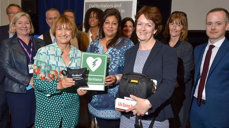 Elizabeth Kitkat headteacher of Camden School For Girls takes delivery of a defibrillator for the sc