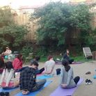 A previous yoga session at Dalston Eastern Curve Garden in Dalston Lane