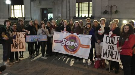 Students with fake baby bumps and dolls protested outside Islington Town Hall.