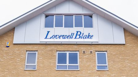 OFFICIAL OPENING: RIBBON CUT: Lovewell Blake staff outside their new Lowestoft office premises at Qu