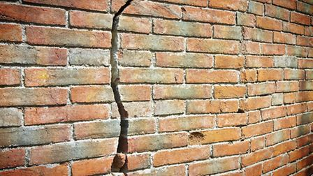 A crack caused by subsidence in the wall of a home