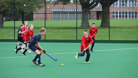 Hockey players from Cromer Academy and East Point Academy (red), in Lowestoft, in action. Pictures: