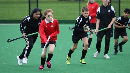 Hockey players from East Point Academy (red) and The Hewett Academy. Pictures: Courtesy of Inspirati