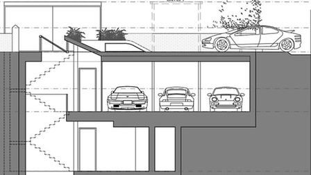 Plans for the 'Batcave' reveal a high-tech 'car lift' to slot vehicles into a below-ground garage