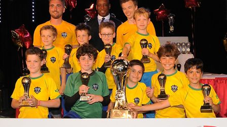 The Muswell Hill Football Academy Under-10 Eagles squad, pictured with ex-Arsenal and England strike