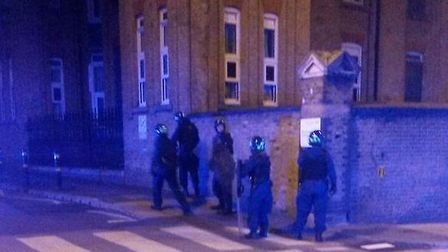 Police outside the John Howard Centre during last year's disturbance (Picture: Meir Taub)
