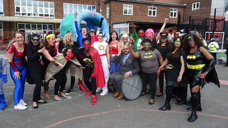 Staff at Tyssen Primary School, with Hannah Greene (superwoman, back middle)