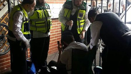 Medics from private ambulance firm Hatzola treat the patient. Picture: @Shomrim