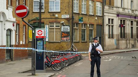 Police at the scene or the murder in Camden Town Dominic Lipinski/PA Wire
