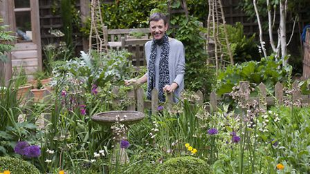 Linette Ralph in her Crouch End garden, which she opens to the public. Picture: Nigel Sutton
