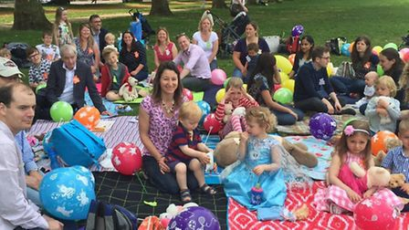 Friends and family gather in Hyde Park to play games, sing songs and enjoy a picnic