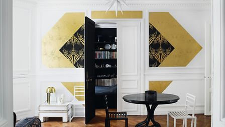 Gold and black make a contrast on a white wall, from an image in White Rooms, by David Harrison and