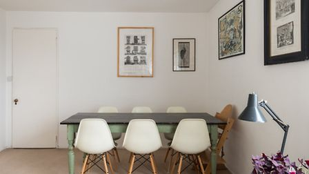 Mismatched framed art, an anglepoise lamp and Eames chairs, a Pinterest hat trick