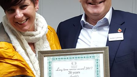 Kerry being presented with her certificate by Gordon Cochrane, CEO of Healthcare Homes Group. Pictur