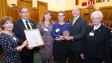 The team from St Joseph's Hospice pick up their Civic Award at the Town Hall, presented by Mayor Pip