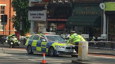 Police cordon off Finchley Road near the junction with Heath Drive