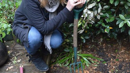 Catherine Woolgar was clearing her flower bed when she came accross the strange object.