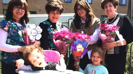 Pupil Miriam Weiner presents flowers and cards to Perelle Kraus, Rivka Breuer, Polly Altutsky and Sa